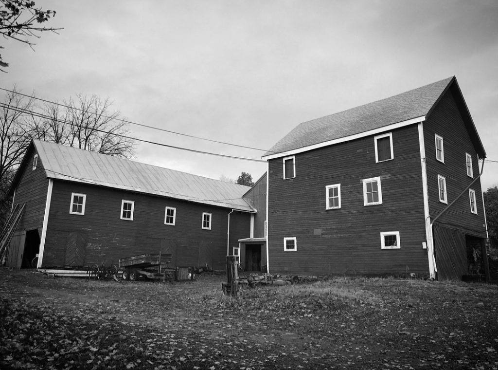 Black and White photo of an aged barn.