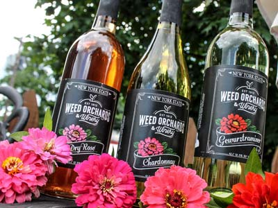 Three bottles of Weeds Wine. Dry Rose, Chardonnay and Gewurztraminer
