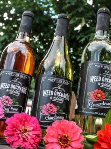 Three bottles of Weed's Wine.