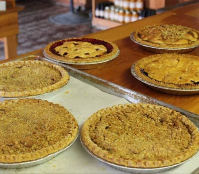 Fresh pies including apple crumble and cherry.