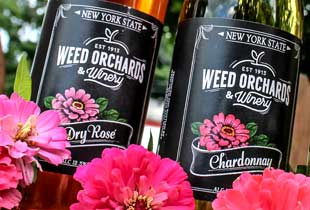 A close up of weed's Dry Rose and Chardonnay bottles.