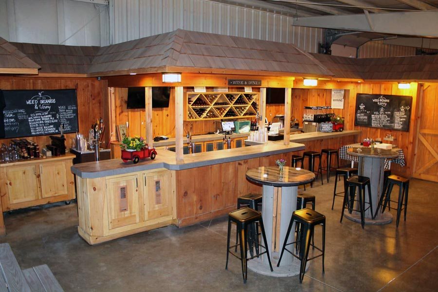 A tasting Room with woodwork and metal barstool benches