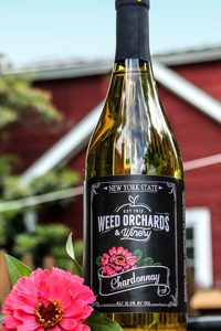Chardonnay bottle featuring a hot pink zinnia