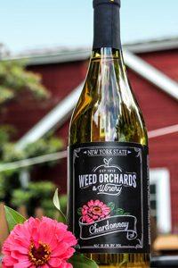 Chardonnay bottle featuring a hot pink zinnia