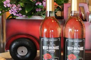 A red truck planter and bottles of wine
