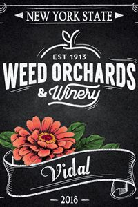 Vidal bottle featuring a coral colored Zinnia on the label.