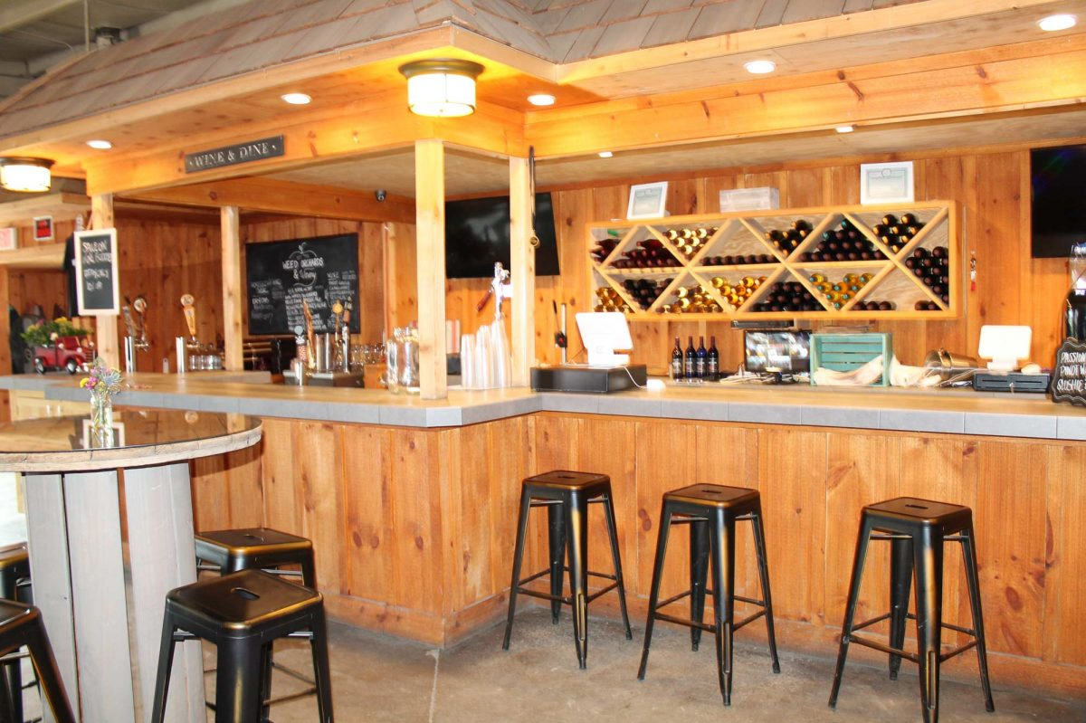 A side view of the winery that shows bar stool seating near the winery counter.