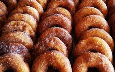 A close up of an entire tray of apple cider donuts